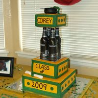 College Graduation Cake A friend of ours was graduating with his Master's degree. He LOVES Guiness beer so the tiers were made with 4 bottles. The colors were...