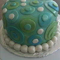 """feeling Blue"" Chocolate fudge peanut butter cake and frosting that's covered with fondant."