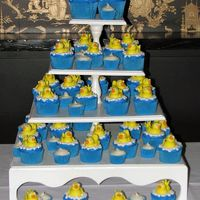 Tower Of Duckies  Instead of a Grooms Cake, the couple opted for cupcakes. And the bride and groom gave each other rubber duckies through out their courtship...