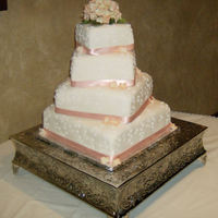 Offset Square Wedding Cake Offset square wedding cake. Three tiers were chocolate with chocolate buttercream and one was white with white buttercream Handmade...