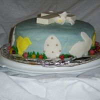 Easter Cake I made this cake with blue crusting cream cheese frosting and fondant accents. The cross is made of chocolate and I bought the flowers. I...