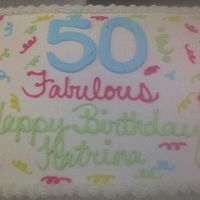Mom's Birthday Cake This is the cake that I made for my mom's 50th Birthday. Its all done in buttercream.