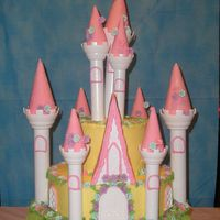 Fairytale  this was done for a friends grandaughter turning 3. It is my first 1 to make. i need more practice the towers are leaning but the little...