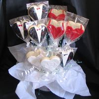 Cookie Bouquet Bridal Shower Gift  Cookies are in a 4 cup Pyrex measuring cup with black utensils standing upright behind cookies (can't really see them with black...