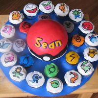 Pokeball Cake And Pokemon Cupcakes  Made this for my sons 9th birthday party. Sports ball pan for pokeball, covered in fondant (not easy and didn't go well). Letters were...