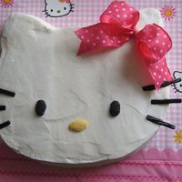 Hello Kitty   White Cake w/buttercream. Bow is real ribbon.