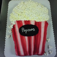 Popcorn Cupcake Cake Made with 24 cupcakes all buttercream. The stripes are airbrushed.