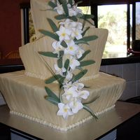 Square Topsie Turvie Chocolate Wedding Cake inside main cake is 1/2 & 1/2 white mud and dark mud, also caramel mud top tier. bailey'd buttercream layers, vanilla buttercream...