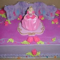 First Barbie Cake Chocolate cake with chocolate mousse - purchased my first licensed cake topper. Copied cake pictures they supply, wasn't as...