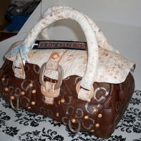 Purse Cake My first handbag/purse cake, all chocolate with choc ganash, fondant details TFL