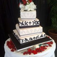 Black And White Wedding Cake This is based on a cake by Ron Ben Israel- His cake was absolutely stunning, refined and basically perfect in every way. Mine not so much!...