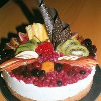 Mint Mousse Cake Decorated With Fruits And Chocolate