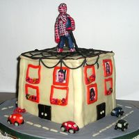 Spiderman On A House Cake for my cousine who loves spiderman. I think the cake came out terrible, but he liked it.