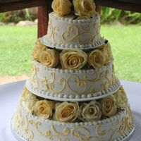 Yellow Scrollwork Cake This was my wedding cake. Frosted with buttercream, and the flowers were silk.