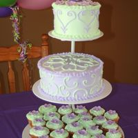 Three Tiered Tinkerbelle Cakes decorated in Bettercream frosting. The flowers on the cupcakes are made from mmf.