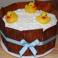 Rubber Duck Shower Cake Bettercream frosting for the bubbles, fondant board, rubber ducks on top.