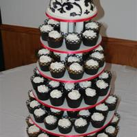 Black And White Cupcakes With Damask Topper This cake was frosted with buttercream, as were all of the cupcakes. I used the Cricut to cut out all of the cupcake wrappers as well as...