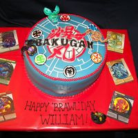 Bakugan Chocolate WASC with vanilla frosting covered in MMF with gumpaste and RI accents.