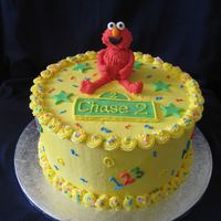Elmo Marble cake with vanilla b/c. MMF Elmo and accents. Inspired by lots of great Elmo cakes in the gallery.