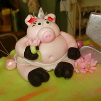 Pretty Piggy Cak   The piggy on top is a copy of the my friends little girl's favorite stuffed animal!