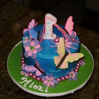 Kinzi's Smash Cake  1st B-day cake. Day shared with her sister's birthday which was a Halloween party. Her mom dressed her as a butterfly and wanted the...