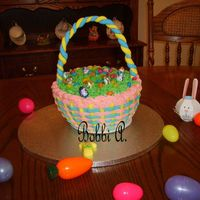 Easter Basket   Poppyseed cake w/ lightly lemon flavored BC and fondant handle.