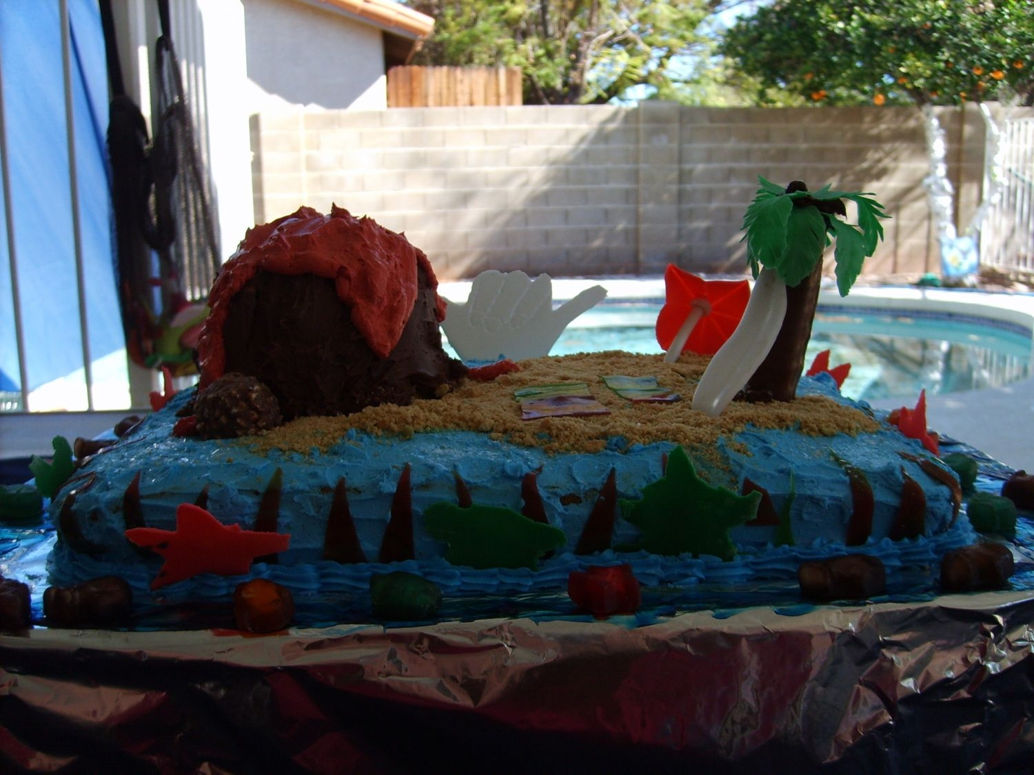 Hawaii Cake  My 8 yr old great nephew had to make a Hawaiian themed cake for Boy Scouts to be bid on to raise money for the troop. We pulled a few ideas...