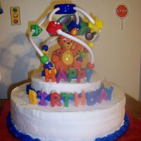 Einstein Cake This cake was made for my son's first birthday. The theme was Baby Einstein. A suction cup toy was placed on top of a two tiered cake...