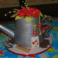 "Watering Can cake carved from 3, 8"" rounds. made for lady who loves to garden. covered in fondant and painted with silver and copper dust."