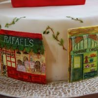 "Other Shops pics of handpainted fondant ""shops"" on another side of the cake. whole cake picture is posted separately."