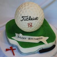 "Golf Ball Cake 6"" fondant covered golf ball, 8"" carved green. chocolate tees. i forgot to put the club head on golf club...oh well!"