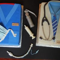 Doctors Farewell 2 9x13 cakes covered in fondant made for anesthesia doctors farewell party. all accents and instruments are fondant/gumpaste. everything is...