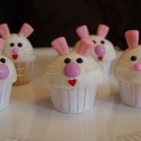 Bunny Cupcakes mini cupcakes made to go with chick cupcakes for DD's class. buttercream with bunny corn ears, fondant eyes and candy noses. whiskers...