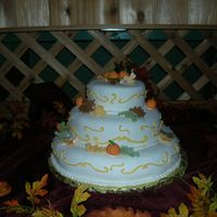 Fall Wedding Bride and groom wanted a fall theme, leaves and pumpkins made from fondant.