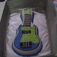 Guitar Cake This was the first cake I sold. Made with BC icing. I used the guitar pan made by wilton.