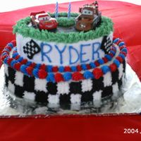 Cars 2 Tier Cake This cake is BC icing with 2 Cars diecast cars on it.