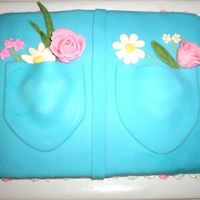 Jean Pocket Cake With Flowers This was my first fondant cake. I used gum paste for the roses, daisies, and leaves. I used Royal icing on everything else except the blue...