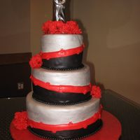 Red, Black Silver Wedding Cake Made for a cousin and his fiancee, very special couple espcially as I lived with them for 4 months. Cake design was inspired by a wilton...