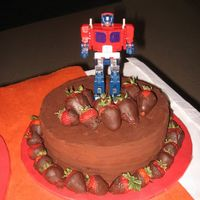 Transformers Chocolate Cake A surprise for my brother, he requested the chocolate zucchini cake and ganache. He saw Optimus Prime immediately when they made their...