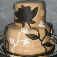 "Graphic Flowers And Leaves A background pattern I found on a website... had trouble with black MMF as it lost all elasticity. The cake was delicious anyway! 4"" (..."