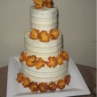 Dried Pineapple Flower Cake 4, 6, 8 rounds of hummingbird cake with cream cheese icing. Tried my new Wilton decorating triangle... wouldn't do it again with a...