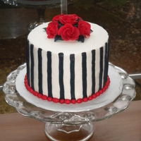 "Gothic Roses  6"" round cake, frosted with buttercream with black buttercream stripes, and deep red chocolate roses. Made for the cake walk at the..."