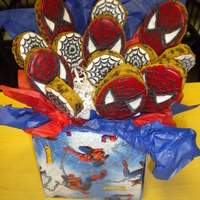 Spiderman Cookie Bouquet! Chocolate chip cookie Spiderman and web cookie bouquet. I used an egg shaped cutter for Spiderman, and round cutter for the webs. Decorated...
