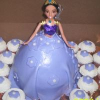 Barbie Cakes2 barbie with a purple dress with some cupcake with mmf flowers.
