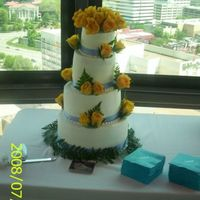 Yellow Roses Wedding Cake Four tier wedding cake with blue satin ribbon & yellow rose