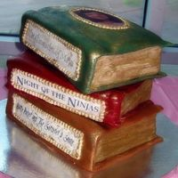 Books.jpg Two layers are chocolate with peanut butter filling, the third is vanilla. Covers and pages done with rolled fondant, the picture on the...