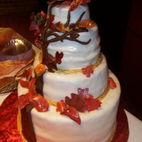 Fall Leaves Wedding Cake  This is a fall wedding cake with oak tree symbolic of the couples spiritual life. The leaves are all done in gumpaste and handpainted and...