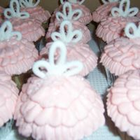 Little Princess Tiara Cupcakes   These are little cakes with flower petals to resemble mums topped with a royal icing crown.