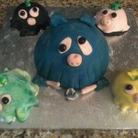 Sea Monster Mini Cakes  The are just silly fun cakes made with my 11 year old daughter using all the left over fondants and cake that we mixed into balls with BC...