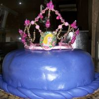 Her Majesty's Cake  This is MMF with a carved pillow cake colored in purple gel. There is a button on top with markings and the braid around bottom. Pillow is...